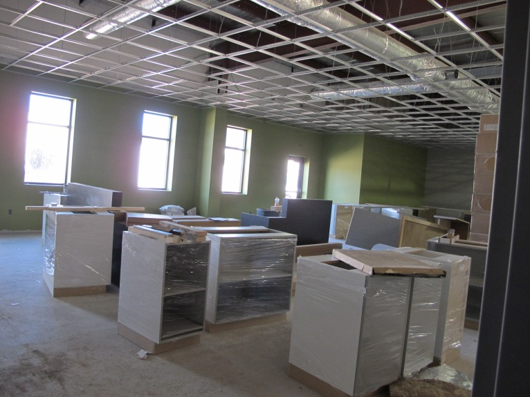 The cabinets are being staged in the conference room.